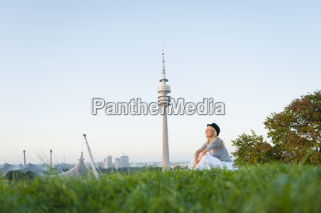 young woman looking at city skyline