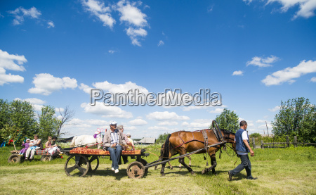 large family groups riding on horses
