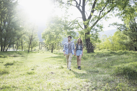 young couple strolling in sunlight piemonte