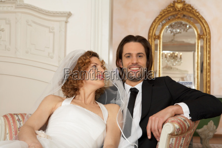 young bridal couple sitting together