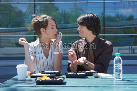businessman and woman on table