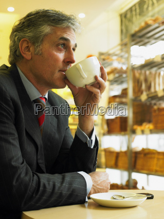 mature businessman sitting in cafe