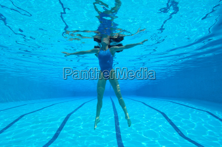 woman in swimming pool underwater view
