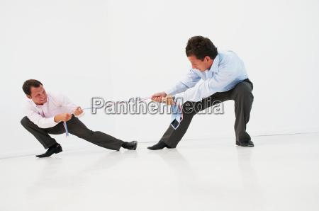 two men having tug o war