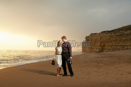 man and woman strolling along a