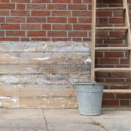 weathered wood surface with ladder and