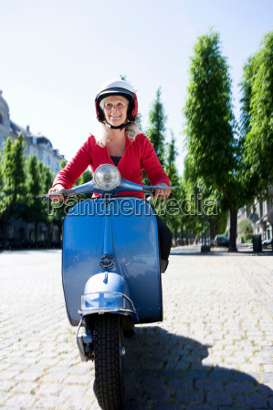 woman driving a scooter