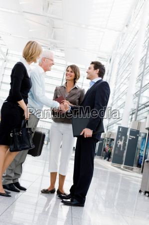 4 people greeting each other