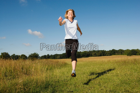 woman running in field