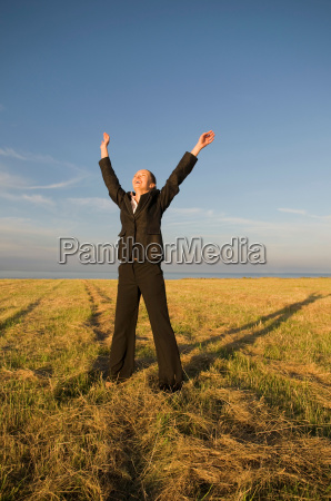 business woman in a field with