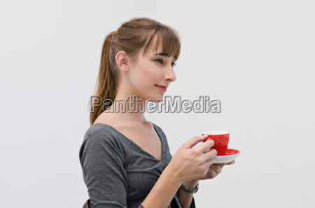 female holding a red cup