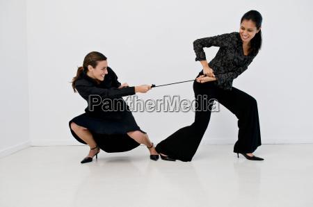 women having a tug of war