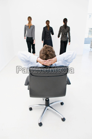 a business man reclining in chair