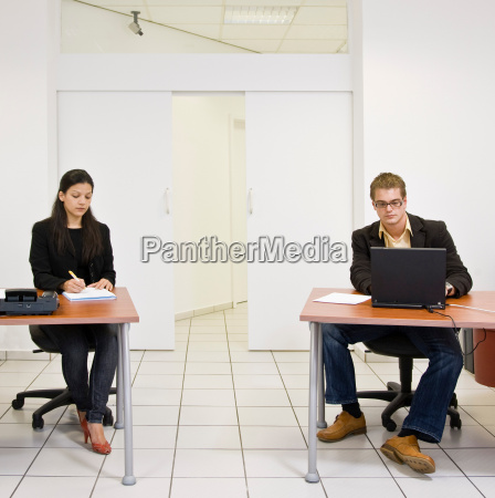 co workers at desk in office