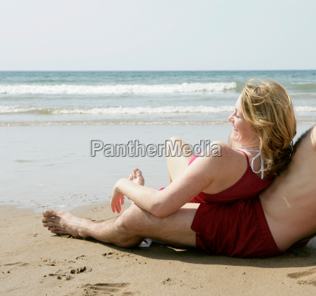 woman relaxing by beach