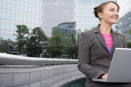 business woman using laptop outside