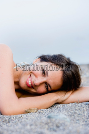 woman laying on the beach