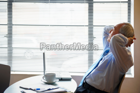 senior businessman relaxing in cafe