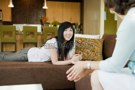 teen girl talking with her mother