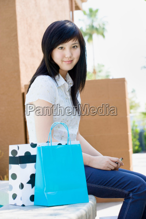 teen with shopping bags and mobile