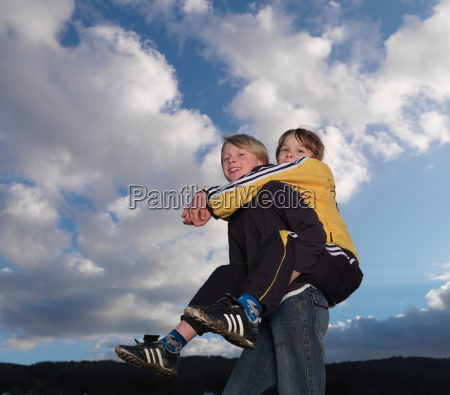 boy carrying girl piggyback style