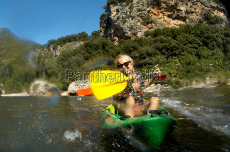 young girl doing kayak on a