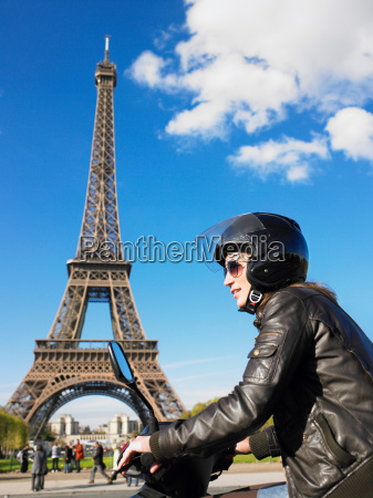 woman on moped in paris