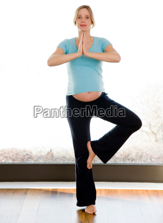 pregnant woman doing yoga exercises