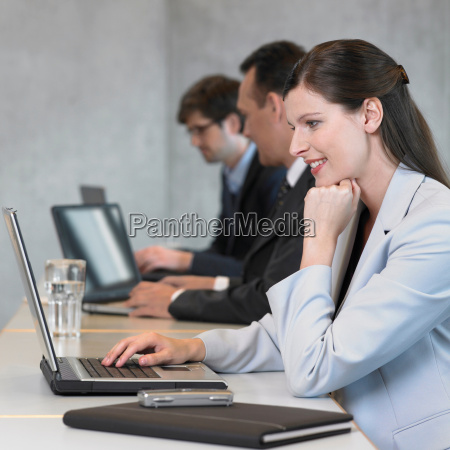businesswoman using laptop smiling