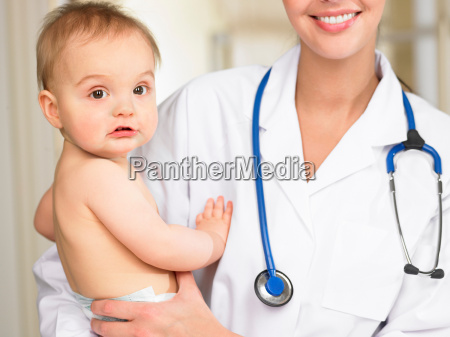 doctor carrying baby boy