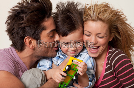 couple close up with young boy