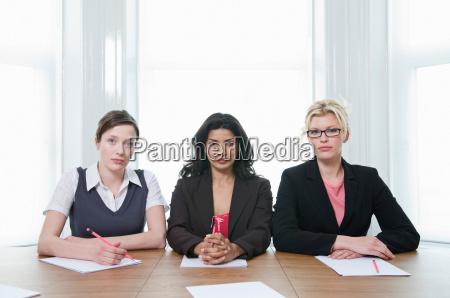a portrait of three businesswomen