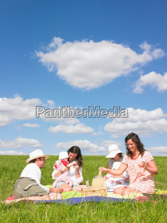 young people on picnic blanket