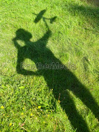 shadow of a woman holding an