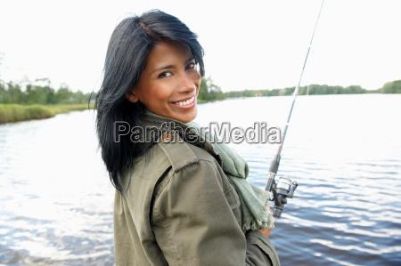 woman fishing smiling at camera