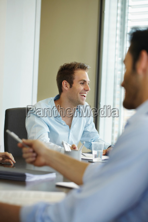smiling young man in business meeting