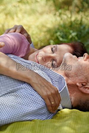 close up of older couple embracing