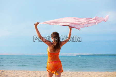 woman flying cloth at the beach