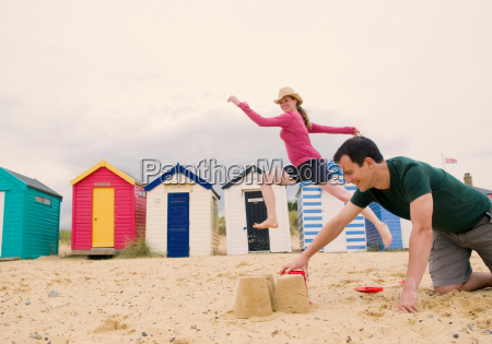 couple have fun on beach