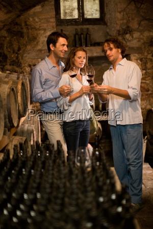 man explains wine to couple