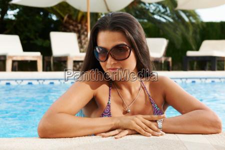 girl in hotel swimming pool