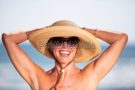 woman standing by beach