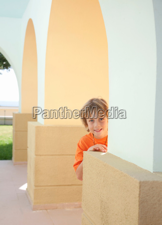 boy standing by wall