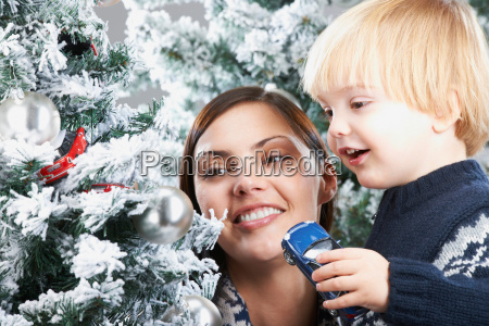 mother and son decorating a xmas