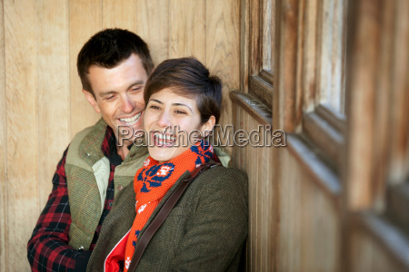 couple laughing together in hut in