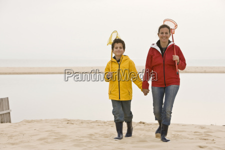 mother and son on beach with