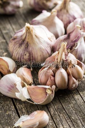 tasty garlic on wooden table