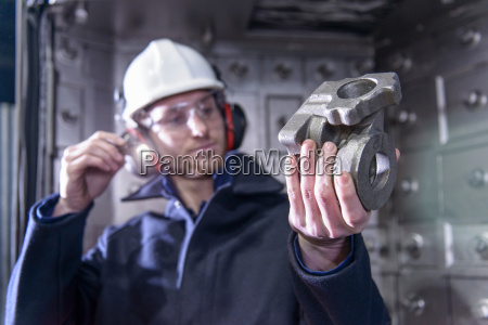 worker using torch to inspect cast