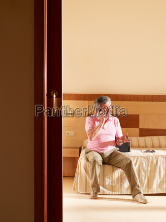 senior adult man in hotel room