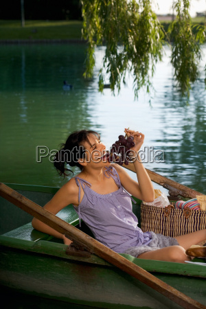 woman having a picnic on boat